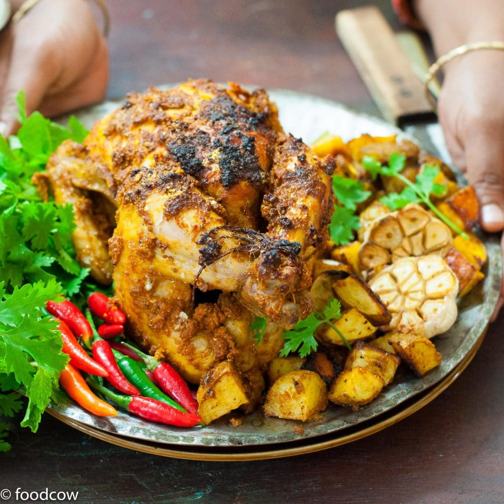 Easy Indian Style Chicken Roast Recipe - Whole Chicken & potatoes roasted with desi indian spices ,yogurt and Ghee.