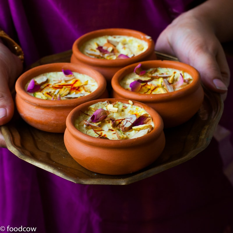 Kesar Phirni Recipe - Creamy Indian Rice Pudding infused with Saffron and cardamom - served chilled with slivered almonds and Pistachios.