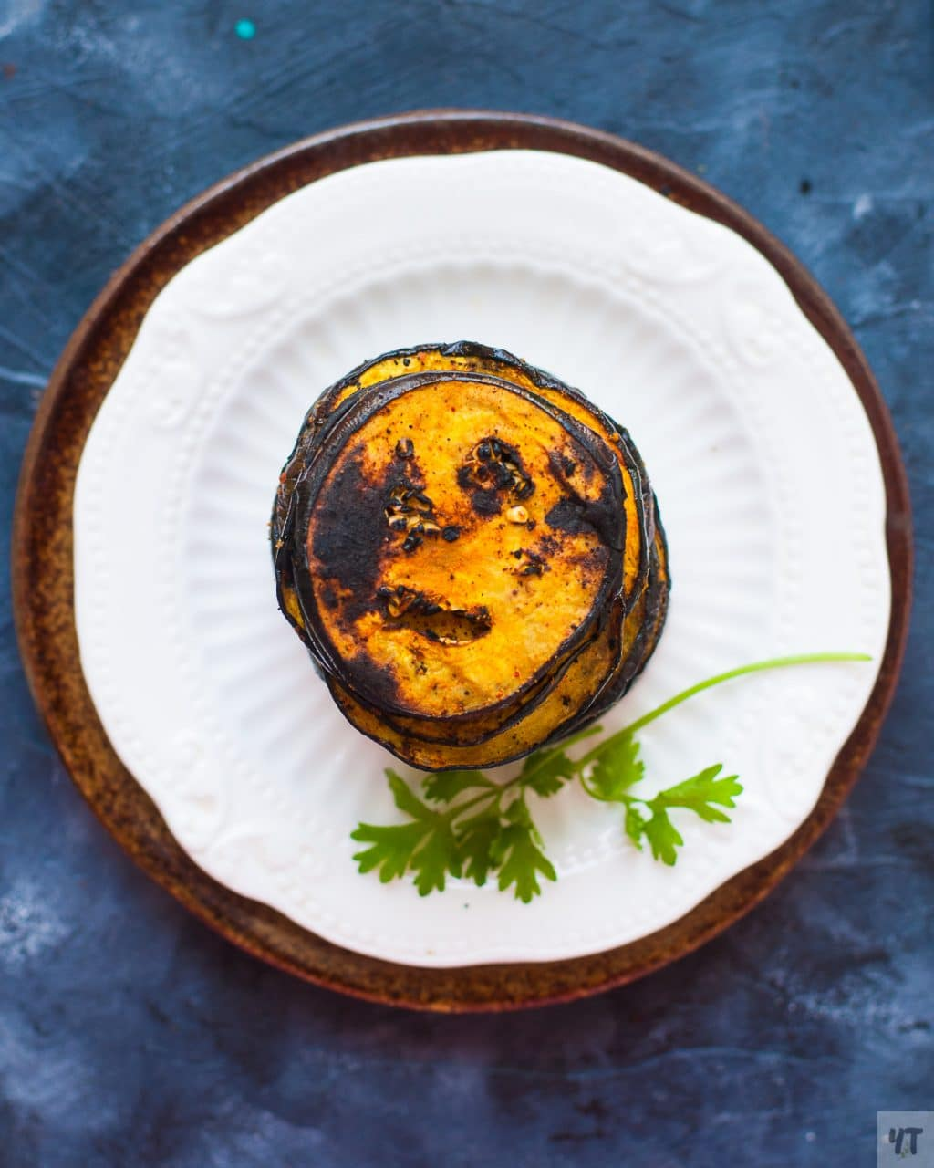 Healthy Baigan Bhaja - Smoky Eggplant Roasted in very little oil and charred over the fire for a smoky taste. Low Carb, Vegan & Paleo recipe. #eggplant #indian #paleo #whole30 #vegan #smoky #baigan #bhaja #roastedeggplant #vegetarian #lowcarb