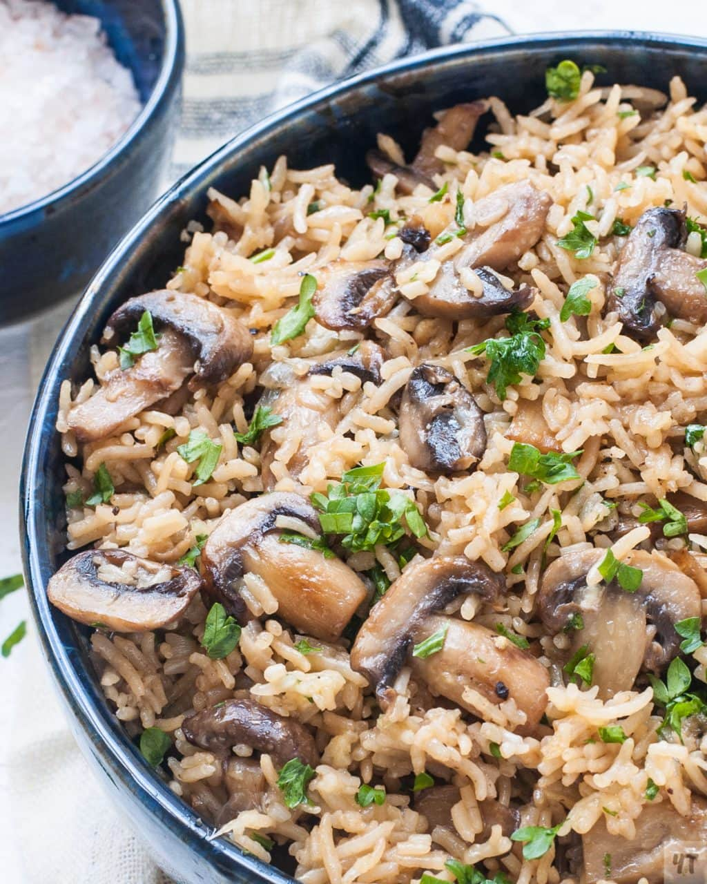 Mushroom Parmesan Rice- Buttery Cheesy Parmesan rice with caramalised mushrooms,garlic and parsley made in pressure cooker within 30 minutes. #mushroom #instantpot #parmesanrice #rice #mushroomrice #recipe #vegetarian #pressurecookerrice